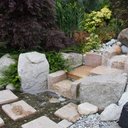 Stepping stones across the water feature